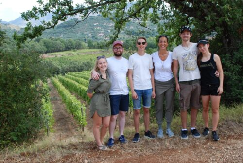 A group of people in the vineyards