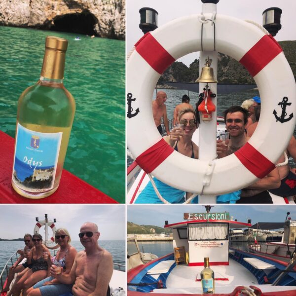 A group of people on a boat tour in Sperlonga with wine